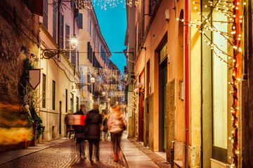 Night old city street decorated for holidays, Parma, Emilia-Romagna, Italy © iryna1