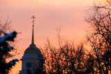 Orthodox church in Russia against the backdrop of the sunset