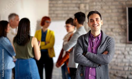 Fridge magnet Portrait of businessman with colleagues.