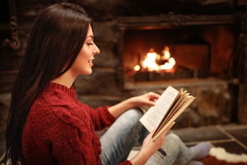 Profile of young woman while reading book