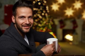 Man at home in Winter at Christmas