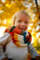 portrait of child boy in autumn park. The concept of childhood, family and kid