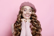 beautiful young female model with long wavy hair wearing pink beret and scarf
