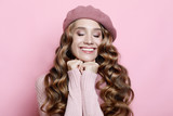 beautiful young female model with long wavy hair wearing pink beret and scarf - 226050221