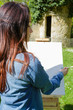 young lovely woman painting outdoors - 226069064