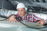 plasterer putting insulation on the ceiling - 226070840