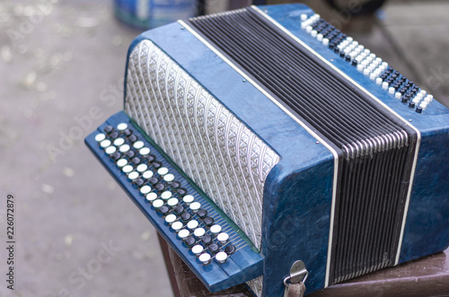 Fragment of classical retro bayan (accordion), musical instrument  - 226072879