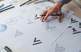 Graphic designer development process drawing sketch design creative Ideas draft Logo product trademark label brand artwork. Graphic designer studio Concept. - 226078297