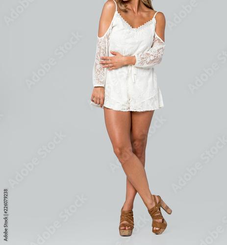 Model in a Cute White Lace Romper