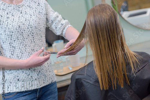 Leinwandbild Motiv picture showing hairdresser holding scissors and comb