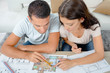 young couple looking at blueprint project together