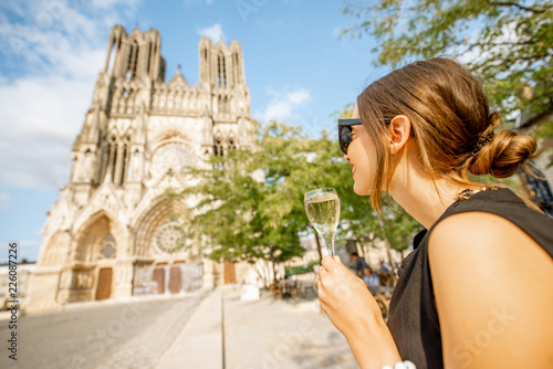 Leinwandbild Motiv Woman with a glass of champagne in Reims, France
