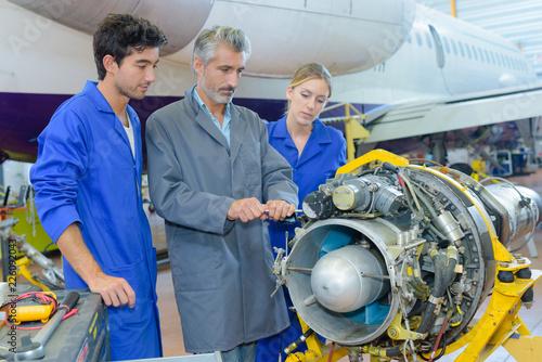 Students looking at aircraft turbine
