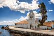 Leinwanddruck Bild - The Panagia Vlacherna Monastery with a nice cloudscape in Corfu, Greece