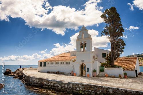 Leinwanddruck Bild The Panagia Vlacherna Monastery with a nice cloudscape in Corfu, Greece