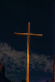 cross in the middle of the sky and the Church