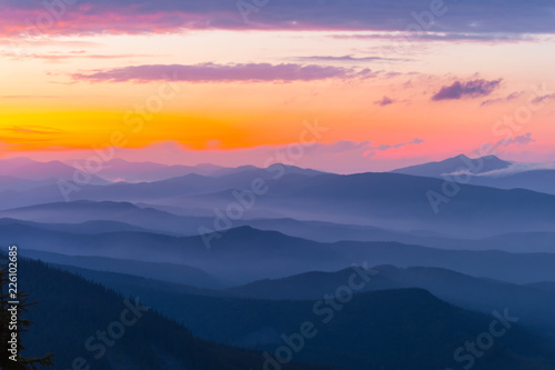evening mountain silhouette in a blue mist at the twilight