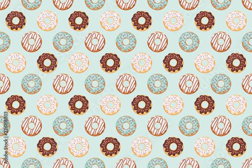 Śliczny wzór z oszklonymi donuts. Kolory niebieski i beżowy. Girly. Do druku i internetu.