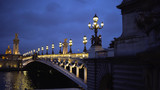 Romantic scenery with lights and sculpture on historic French bridge in Paris