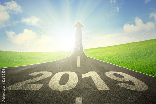 Leinwanddruck Bild Road with numbers 2018 and upward arrow