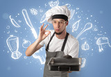 Young cook with kitchen instruments and drawn recipe concept on wallpaper - 226154845