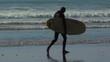 Surfer walks on beach with Surf board. 4K