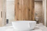 Wooden bathroom interior, white tub