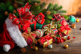 Christmas balls and gift boxes on wooden background