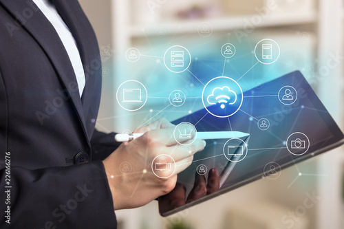 Leinwandbild Motiv Business woman using tablet with network security and online storage system concept