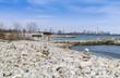Rocky beach at Lake Ontario wih view of Toronto skyline