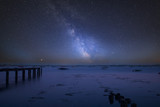 Vibrant Milky Way composite image over landscape of low tide harbour with jetty - 226169060