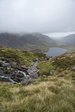 Landscape image of Llyn Idwal in Glyders mountain range in Snowdonia during heavy rainfall in Autumn - 226169253