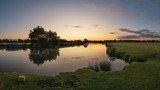 Beautiful dawn landscape image of River Thames at Lechlade-on-Thames in English Cotswolds countryside