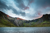 Beautiful sunset landscape image of Llyn Idwal and Devil's Kitchen in Snowdoina during Autumn evening - 226170027
