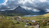 Stunning panoramic landscape image of countryside around Llyn Ogwen in Snowdonia during early Autumn with Tryfan in background - 226170871