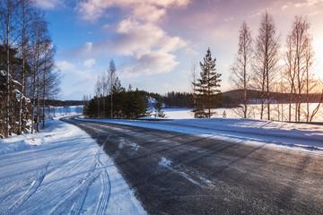 Empty rural road on a lake coast, winter