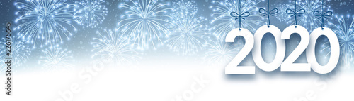 Blue 2020 New Year banner with fireworks.