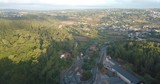 Aerial view, morning traffic, Sintra, Portugal. Beautiful curvy road, lots of traffic. Drone flies backwards. Green trees and cars driving. - 226185847