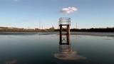 Lagoon sludge at the factory. Dolly camera movement. Wide shot. - 226194017
