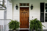 Brown Wood Front Door of a White Siding Southern House - 226195241