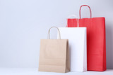 Colorful paper shopping bags on grey background - 226197284