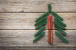 Quadro Christmas tree made from cinnamon and fir-tree branches on wooden table