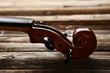 Violin head on brown wooden table