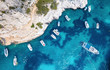 Yachts at the sea in France. Aerial view of luxury floating boat on transparent turquoise water at sunny day. Summer seascape from air. Seascape with motorboat in bay. Travel concept and idea