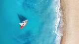 Yacht on the water surface from top view. Turquoise water background from top view. Summer seascape from air. Travel concept and idea - 226203609