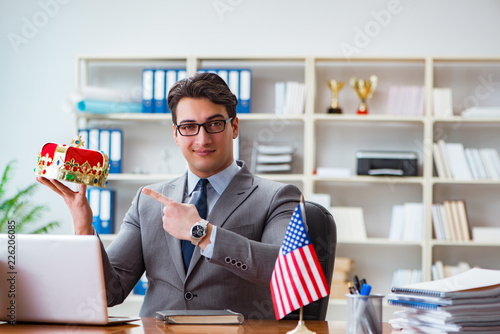 Leinwandbild Motiv Businessman with American flag in office
