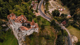 Aerial view of Bran castle in beautiful Transylvania, region of Romania. Cloudy day with dark clouds