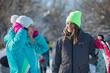 Happy women snowboarders on slope