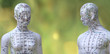 Leinwandbild Motiv Männliches und weibliches Akupunkturmodell vor grünem Hintergrund