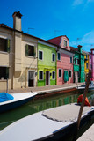 Colourful and picturesque houses alongside the canal on the Burano island.